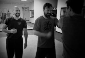 Wing Chun Sifu Ray teaching students with a smile
